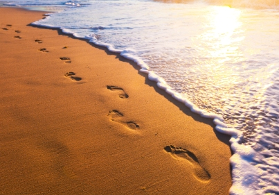beach__wave_and_footsteps_at_sunset_time_by_macinivnw-d68m4ky